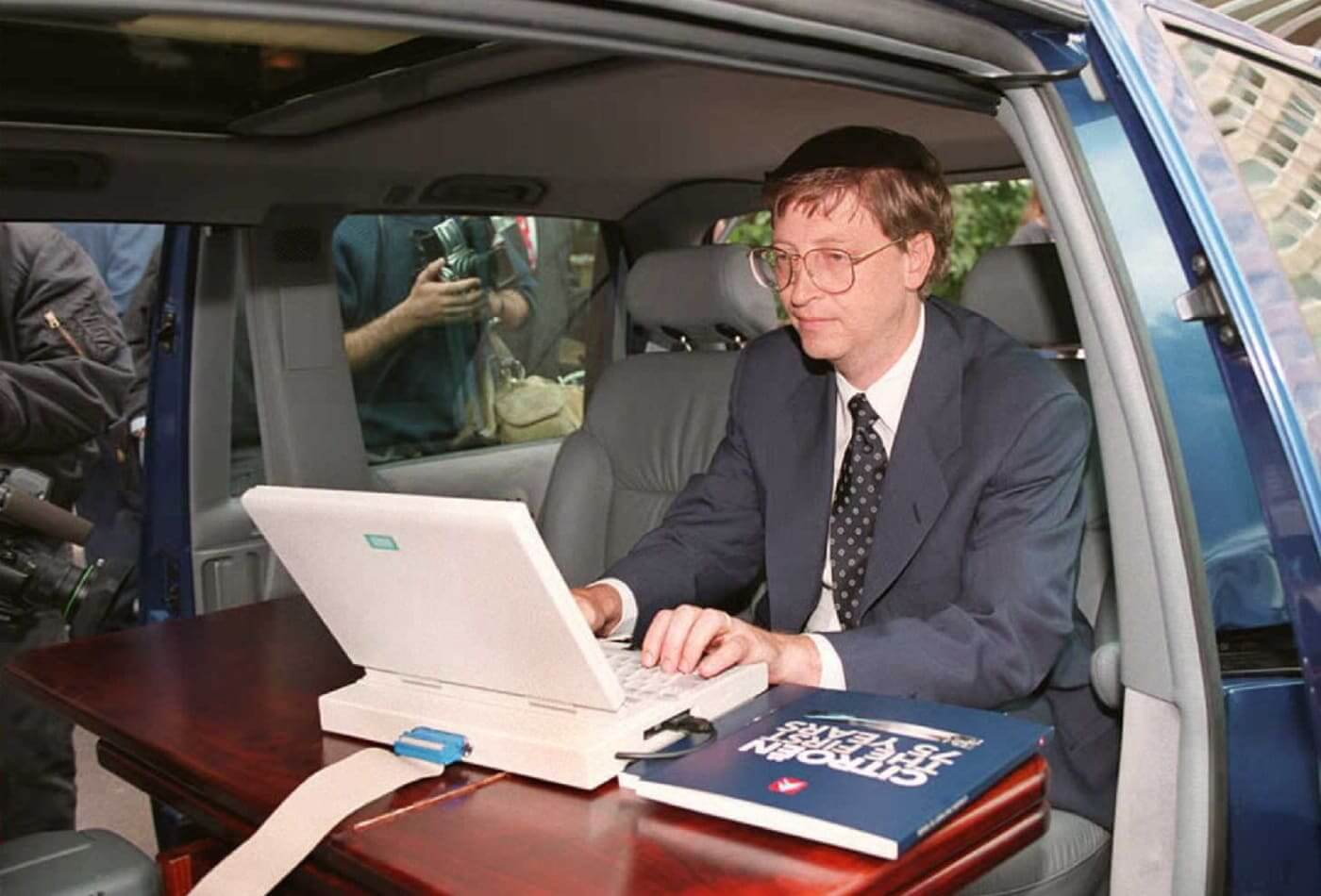 In 1995, Microsoft president Bill Gates demonstrated Microsoft's Windows 95 program from his automobile prior to a press conference in Paris 04 September.